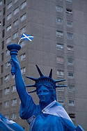 A mock Statue of Liberty with a Scottish flag at a pro-independence march in the Craigmillar district of Edinburgh on the day of the independence referendum. Yes Scotland were campaigning for the country to leave the United Kingdom, whilst Better Together were campaigning for Scotland to remain in the UK. On the 18th of September 2014, the people of Scotland voted in a referendum to decide whether the country's union with England should continue or Scotland should become an independent nation once again and leave the United Kingdom.