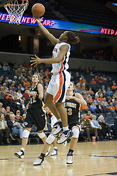UVA's Monica Wright (22) scores on a finger roll layup against Wake Forest.  The Cavaliers defeated the Demon Deacon 77-71 on January 11, 2007 for their first ACC win in the John Paul Jones Arena in Charlottesville, VA.<br />