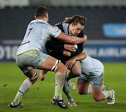 Ospreys' Jeff Hassler is tackled by Saracens' Jackson Wray<br /> <br /> Photographer Simon King/Replay Images<br /> <br /> European Rugby Champions Cup Round 5 - Ospreys v Saracens - Saturday 13th January 2018 - Liberty Stadium - Swansea<br /> <br /> World Copyright © Replay Images . All rights reserved. info@replayimages.co.uk - http://replayimages.co.uk