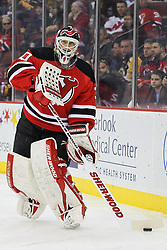 Jan 19; Newark, NJ, USA; New Jersey Devils goalie Martin Brodeur (30) passes the puck during the first period of their game against the Boston Bruins at the Prudential Center.