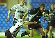© Peter Spurrier/Intersport Images .Tel + 441494783165 email images@Intersport-images.com.30/11/2003 - Photo  Peter Spurrier.2003/04 Zurich Premiership Rugby - London Irish v Sale Sharks.Exiles Michael Horack, is tackled by Sharks Charlie Hodgson.