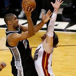 Jun 20, 2013; Miami, FL, USA; San Antonio Spurs power forward Tim Duncan (21) shoots over Miami Heat shooting guard Mike Miller (13) during the second quarter of game seven in the 2013 NBA Finals at American Airlines Arena. Mandatory Credit: Derick E. Hingle-USA TODAY Sports