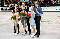 KELOWNA, BC - OCTOBER 26: Pairs silver medalists Kirsten Moore-Towers and Michael Marinaro (r), gold medalists Aleksandra Boikova and Dmitrii Kozlovskii (c) and bronze medalists Evgenia Tarasova and Vladimir Morozov (l) stand on the ice during medal ceremonies of Skate Canada International held at Prospera Place on October 26, 2019 in Kelowna, Canada. (Photo by Marissa Baecker/Shoot the Breeze)