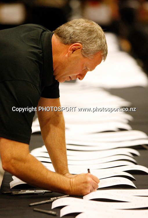 Coach Ricki Herbert, The New Zealand All Whites football team sign merchandise during a signing session at Sky City in Auckland. 19 May 2010. Photo: Andrew Cornaga/PHOTOSPORT