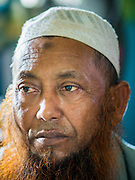 02 JUNE 2015 - KULAI, JOHORE, MALAYSIA: MOHAMED SHAFI bin HABE, is one of the leaders of the Rohingya community in Kulai, Malaysia. The UN says the Rohingya, a Muslim minority in western Myanmar, are the most persecuted ethnic minority in the world. The government of Myanmar insists the Rohingya are illegal immigrants from Bangladesh and has refused to grant them citizenship. Most of the Rohingya in Myanmar have been confined to Internal Displaced Persons camp in Rakhine state, bordering Bangladesh. Thousands of Rohingya have fled Myanmar and settled in Malaysia. Most fled on small fishing trawlers. There are about 1,500 Rohingya in the town of Kulai, in the Malaysian state of Johore. Only about 500 of them have been granted official refugee status by the UN High Commissioner for Refugees. The rest live under the radar, relying on gifts from their community and taking menial jobs to make ends meet. They face harassment from Malaysian police who, the Rohingya say, extort bribes from them.     PHOTO BY JACK KURTZ