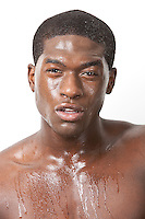 Portrait of young African American man sweating over white background