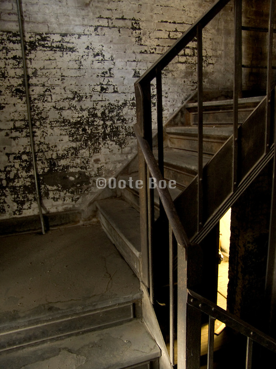 old stairway with open door in the background