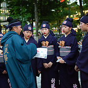 Japanese kids from 5 to 14 years old receive instructions from their coach before their street performance in Sapporo