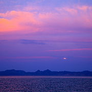 Detail of clouds and moonrising over Coronado island in Loreto. Baja California Sur, Mexico.