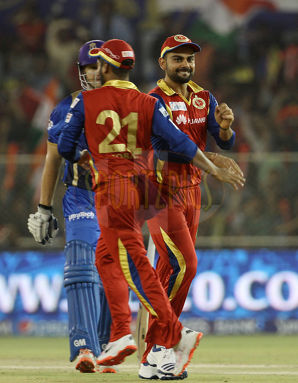 Royal Challengers Bangalore celebrates the wicket of Rajasthan Royals captain Shane Watsonduring match 22 of the Pepsi IPL 2015 (Indian Premier League) between The Rajasthan Royals and The Royal Challengers Bangalore held at the Sardar Patel Stadium in Ahmedabad , India on the 24th April 2015.<br /> <br /> Photo by:  Vipin Pawar / SPORTZPICS / IPL