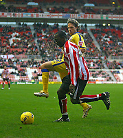 Photo: Andrew Unwin.<br />Sunderland v Southampton. Coca Cola Championship. 11/11/2006.<br />Sunderland's Dwight Yorke clears under pressure from Southampton's Mario Licka.