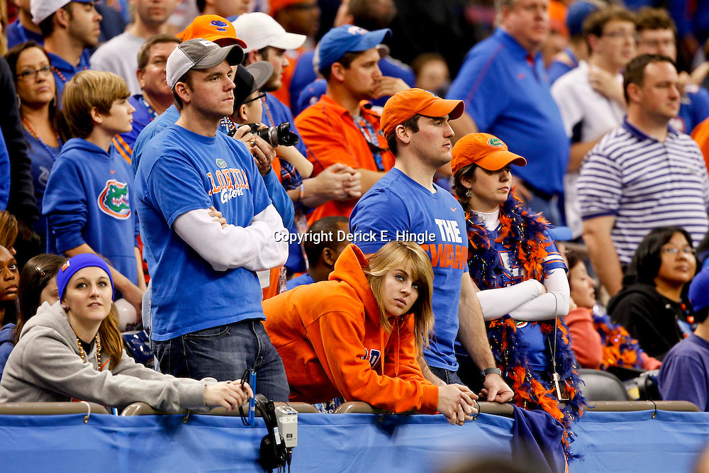Jan 2, 2013; New Orleans, LA, USA; Florida Gators fans look on during the fourth quarter of the Sugar Bowl against the Louisville Cardinals at the Mercedes-Benz Superdome. Louisville defeated Florida 33-23. Mandatory Credit: Derick E. Hingle-USA TODAY Sports