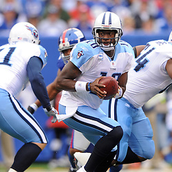 Quarterback Vince Young #10 of the Tennessee Titans sets to handoff the ball during first half NFL football action between the New York Giants and Tennessee Titans at New Meadowlands Stadium in East Rutherford, New Jersey. The game is tied at half time.