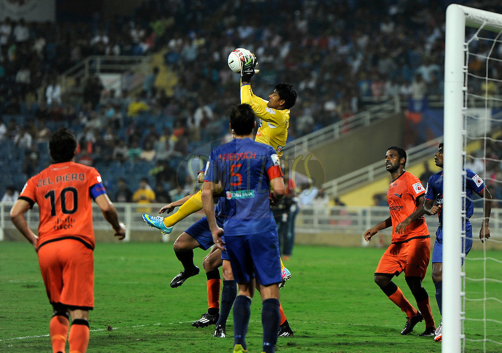Subrata Paul of Mumbai City FC collects the ball during match 22 of the Hero Indian Super League between Mumbai City FC and Delhi Dynamos FC City held at the D.Y. Patil Stadium, Navi Mumbai, India on the 5th November.<br /> <br /> Photo by:  Pal Pillai/ ISL/ SPORTZPICS