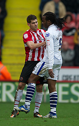 SHEFFIELD, ENGLAND - Saturday, March 17, 2012: Tranmere Rovers' Ian Goodison clashes with Sheffield United's Ched Evans during the Football League One match at Bramall Lane. (Pic by David Rawcliffe/Propaganda)