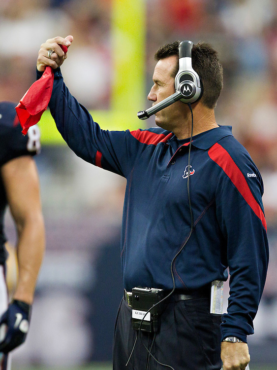 HOUSTON, TX - OCTOBER 9:   Head Coach Gary Kubiak of the Houston Texans waves his red flag during a game against the Oakland Raiders at Reliant Stadium on October 9, 2011 in Houston, Texas.  The Raiders defeated the Texans 25 to 20.  (Photo by Wesley Hitt/Getty Images) *** Local Caption *** Gary Kubiak