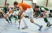 HEEMSKERK- Zaalhockey - Joep van der Loo.  Bloemendaal-Alkmaar.  Copyright Koen Suyk