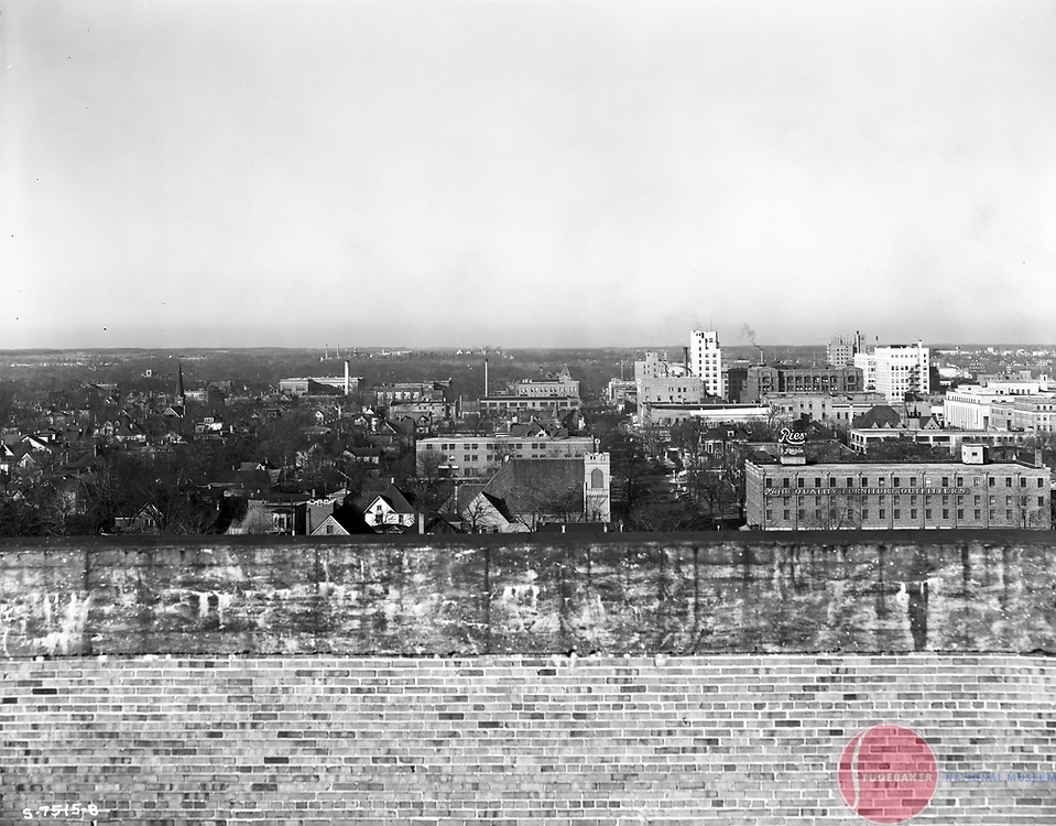 This 1941 image faces north and was taken from the roof of Studebaker building #84. The Ries furniture building is visible in the foreground, as are many other period South Bend landmarks.