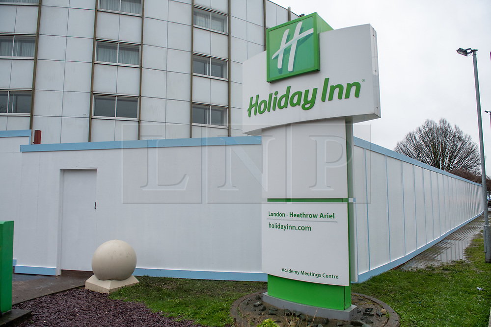 © Licensed to London News Pictures. 28/02/2020. London, UK. A Holiday Inn hotel near London's Heathrow airport has been boarded up around the perimeter as it prepares to be used as a quarantine centre for people that may have been exposed to the COVID-19 coronavirus. Photo credit: Peter Manning/LNP