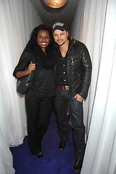 JUNE SARPONG and GERRY DEVEAUX at a party to celebrate the launch of the new purple Sony Ericsson K770i phone held at the Bloomsbury Ballroom, Bloomsbury Square, London on 24th October 2007.<br />