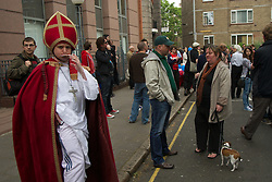 LOCATION, UK  29/04/2011. The Royal Wedding of HRH Prince William to Kate Middleton. Man in white track suit and wearing an Archbishop costume at a republican gathering in red Lion Square. Photo credit should read PAUL TREACY/LNP. Please see special instructions. © under license to London News Pictures