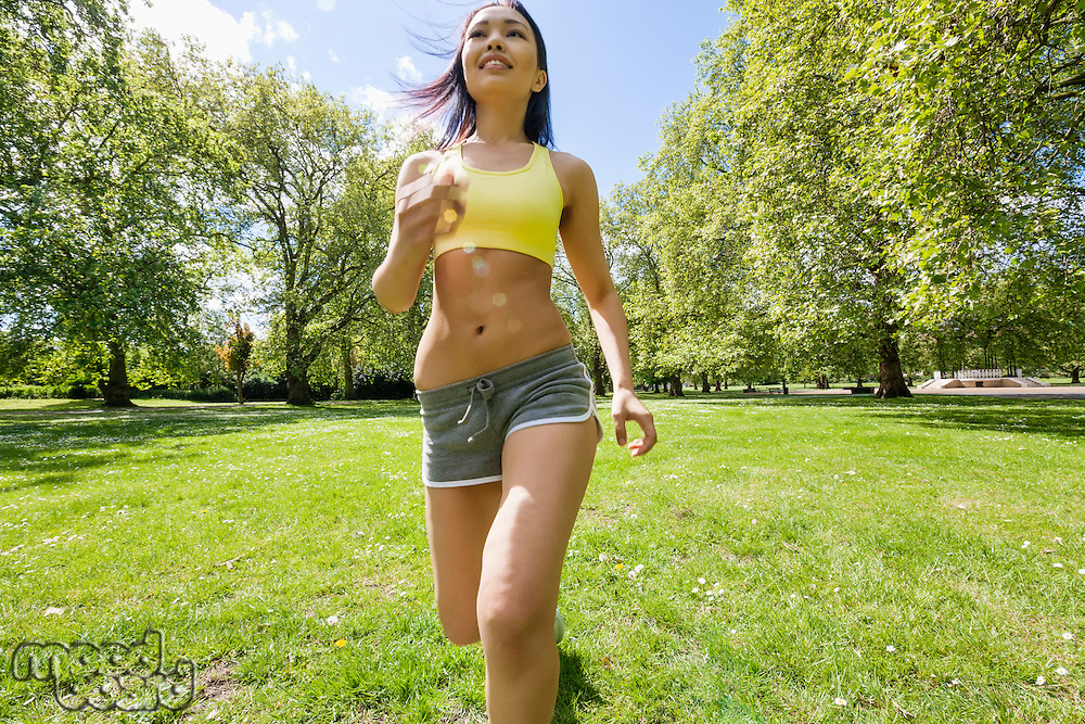 Young fit woman jogging at park