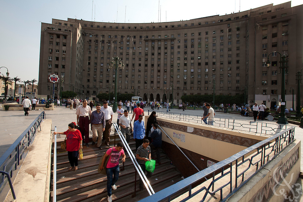 Egyptians head into a subway entrance in front of the civic Mogamma building  in Tahrir Square in central Cairo September 27, 2011. The building, which houses numerous government offices, is viewed as a corner stone of Egyptian bureaucracy.  (Photo by Scott Nelson)