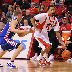 Jan 31, 2009; Piscataway, NJ, USA; Rutgers guard Mike Rosario (3) dribbles past DePaul guard Michael Bizoukas (0) during the first half of Rutgers' 75-56 victory over DePaul in NCAA college basketball at the Louis Brown Athletic Center
