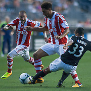 Stoke City F.C. Defender RYAN SHOTTON (30) dribbles the ball up field as Philadelphia Union Defender FABIO ALVES (33) defends in the first half a MLS regular season international friendly match against the Philadelphia Union Tuesday, July. 30, 2013 at PPL Park in Chester PA.