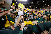 GREEN BAY, WI - SEPTEMBER 28: Randall Cobb #18 of the Green Bay Packers jumps into the stands to celebrate with fans after a touchdown reception against the Kansas City Chiefs during a game at Lambeau Field on September 28, 2015 in Green Bay, Wisconsin. The Packers defeated the Chiefs 38-28. (Photo by Joe Robbins)