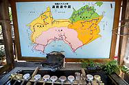 Karta &ouml;ver den japanska &ouml;n Shikoku och de 88 templen som ing&aring;r i pilgrimsvandringen.<br /> Tempel nummer 1, Ryōzen-ji (霊山寺)<br /> <br /> Pilgrimsvandring till 88 tempel p&aring; japanska &ouml;n Shikoku till minne av den japanske munken Kūkai (Kōbō Daishi). <br /> <br /> Fotograf: Christina Sj&ouml;gren<br /> Copyright 2018, All Rights Reserved<br /> <br /> Map of the Shikoku Island and the pilgrimage. Water for prayers at the first temple Ryōzen-ji (霊山寺) of the Shikoku Pilgrimage, 88 temples associated with the Buddhist monk Kūkai (Kōbō Daishi) on the island of Shikoku, Naruto,Tokushima Prefecture, Japan