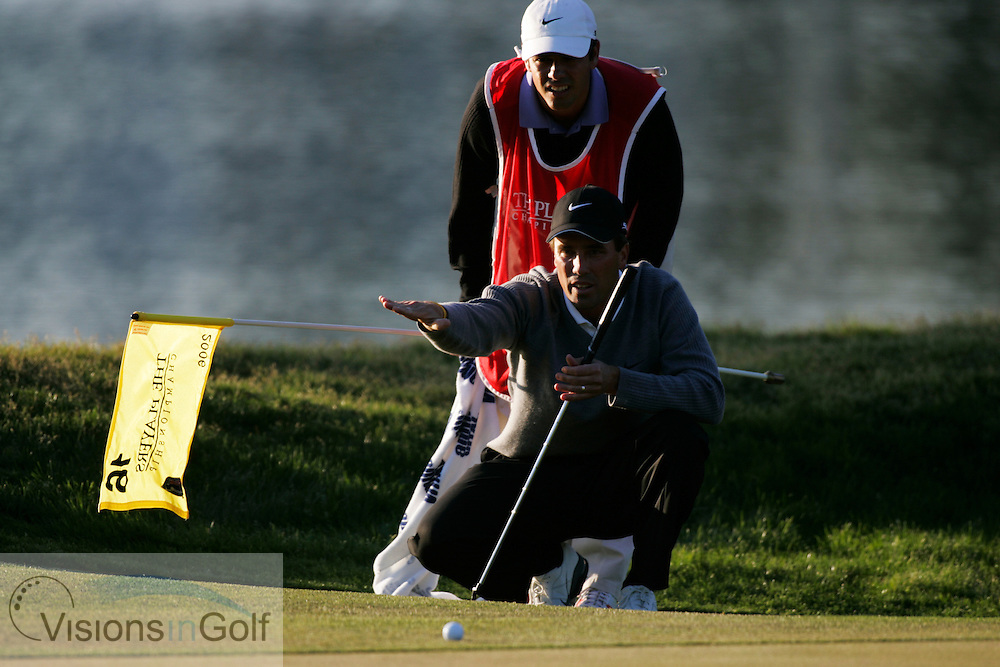 Stephen Ames lines up his putt on the 16th with his caddy brother on his way to winning <br /> THE PLAYERS Championship at TPC Sawgrass GC, Stadium, Ponte Vedra, Jacksonville, Florida USA. 26th March 2006. Day 4 final day<br /> Picture Credit:   Mark Newcombe / visionsingolf.com