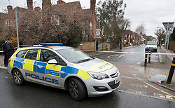 © Licensed to London News Pictures. 02/04/2018. London, UK. A police car remains at the entrance to Ellerton Road in Wandsworth, south west London after 20 year old Devoy Stapleton was stabbed to death at 1am on Sunday 1st April - the 31st fatal stabbing this year in the capital. It is being reported that London's murder rate has overtaken New York's.   Photo credit: Peter Macdiarmid/LNP