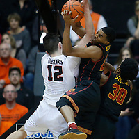 Oregon State's Drew Eubanks, left, and Southern California's De'Anthony Melton, right, fight for a rebound during the second half of an NCAA college basketball game in Corvallis, Ore., Wednesday Dec. 28, 2016. Southern California won 70-63. (AP Photo/Timothy J. Gonzalez)