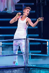 """© Licensed to London News Pictures . 21/02/2013 . Manchester , UK . Canadian pop star JUSTIN BIEBER performs on stage at the Manchester Arena in England on the opening night of his UK """" Believe """" tour . Photo credit : Joel Goodman/LNP"""