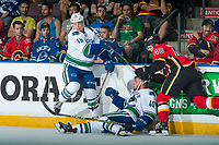 PENTICTON, CANADA - SEPTEMBER 10: Zach Fischer #48 of Calgary Flames checks Aaron Irving #40 as he collides with Kole Lind #78 of Vancouver Canucks on September 10, 2017 at the South Okanagan Event Centre in Penticton, British Columbia, Canada.  (Photo by Marissa Baecker/Shoot the Breeze)  *** Local Caption ***