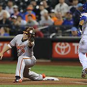 Chris Davis, Baltimore Orioles, makes the out at first base as Juan Lagares, New York Mets, runs to first during the New York Mets Vs Baltimore Orioles MLB regular season baseball game at Citi Field, Queens, New York. USA. 5th May 2015. Photo Tim Clayton