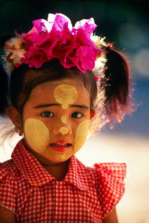 Little Burmese girl wearing thanaka-bark makeup, outside the Ananda Temple, Bagan, Myanamar (Burma)