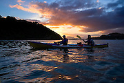 The sun sets during a sea kayaking trip in the Paterson inlet off the coast of Stewart Island, New Zealand, Jan. 7, 2015. (Photo by David Lienemann)