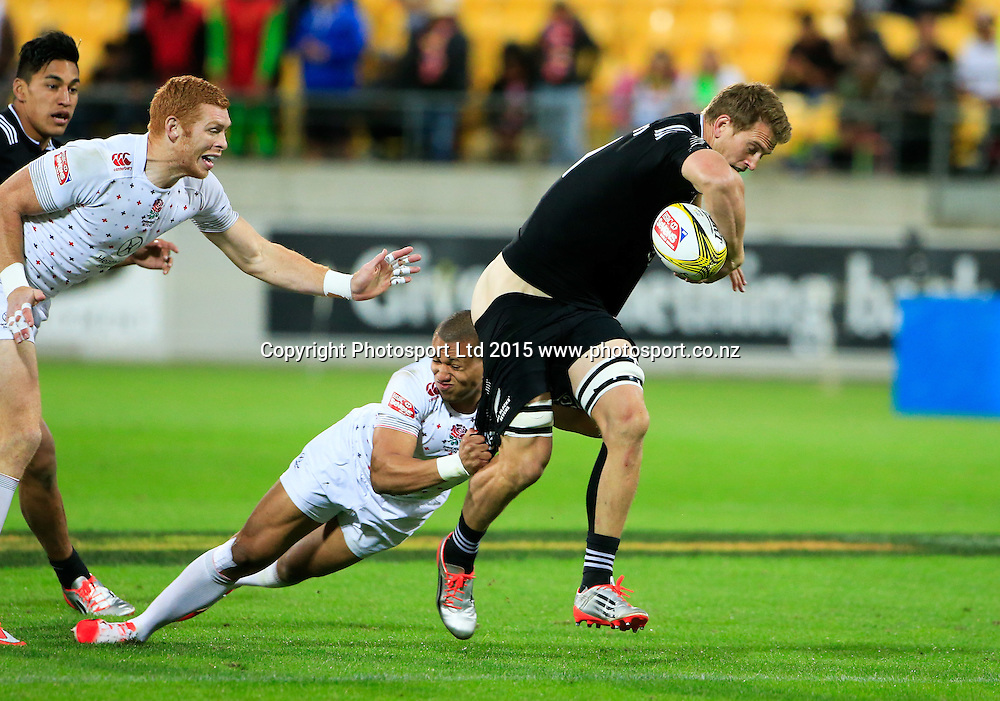 New Zealand's SCott Curry loses his shorts in a tackle in the final against England. Day two of the HSBC Sevens, Westpac Stadium, Wellington, New Zealand. Saturday 07 February 2015. Copyright Photo: John Cowpland / www.Photosport.co.nz