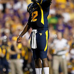 Sep 25, 2010; Baton Rouge, LA, USA; West Virginia Mountaineers quarterback Geno Smith (12) against the LSU Tigers during the first half at Tiger Stadium.  Mandatory Credit: Derick E. Hingle