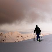 Owen Dudley heads out of the Baker backcountry at the end of winter day of skiing.