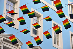 © Licensed to London News Pictures. 07/07/2017. London, UK. Rainbow flags and banners, a symbol for the LGBT community, are on display as Soho prepares for the annual Pride parade tomorrow.   Photo credit : Stephen Chung/LNP