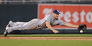 Tampa Bay Rays third basemen Brooks Conrad (36) dives for a ground ball against the Kansas City Royals during the sixth inning at Kauffman Stadium.