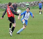 Eamon Cleary Kiltullagh Pioneers and (12) Davey Mahon Kinvara FC in Kiltullagh, Galway. Photo:Andrew Downes
