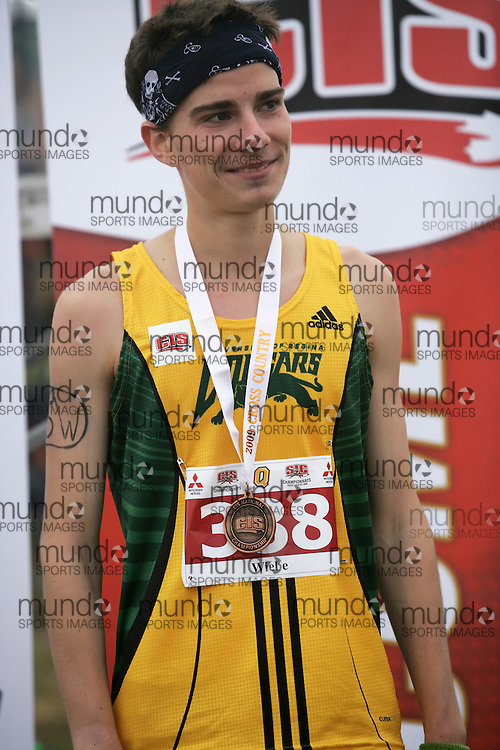 (Kingston, Ontario -- 14 Nov 2009) Kelly Wiedbe of the University of Regina receives his bronze medal at the 2009 Canadian Interuniversity Sport CIS Cross Country Championships at Forth Henry Hill in Kingston Ontario. Photograph copyright Sean Burges / Mundo Sport Images, 2009.