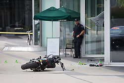 "A police officer stands at the scene as a motorcycle lies on the ground after a female stunt driver working on the movie ""Deadpool 2"" died after a crash on set, in Vancouver, BC, Canada, on Monday August 14, 2017. Vancouver police say the driver was on a motorcycle when the crash occurred on the movie set on Monday morning. Photo by Darryl Dyck/CP/ABACAPRESS.COM"