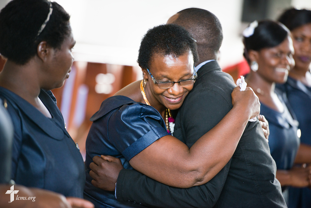 Deaconess Edna Shoo is congratulated after her commissioning on Sunday, March 15, 2015, at the Evangelical Lutheran Church in Tanzania – South-East of Lake Victoria Diocese's (ELCT-SELVD) Ebenezer Cathedral in Shinyanga, Tanzania. LCMS Communications/Erik M. Lunsford