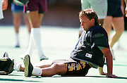 NFC New Orleans Saints kicker Morten Andersen (7) takes a break as he sits on the field turf while practicing during the week of the 1989 NFL Pro Bowl football game against the AFC on Jan. 29, 1989 in Honolulu. The NFC won the game 34-3. (©Paul Anthony Spinelli)