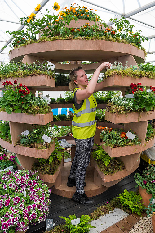 A communal palnter, part of The Great Escape showing alternative uses for outdoor space by The Horticultural Trades Association (HTA)<br /> Exhibitor: Chris Collins - The RHS Chelsea Flower Show at the Royal Hospital, Chelsea.